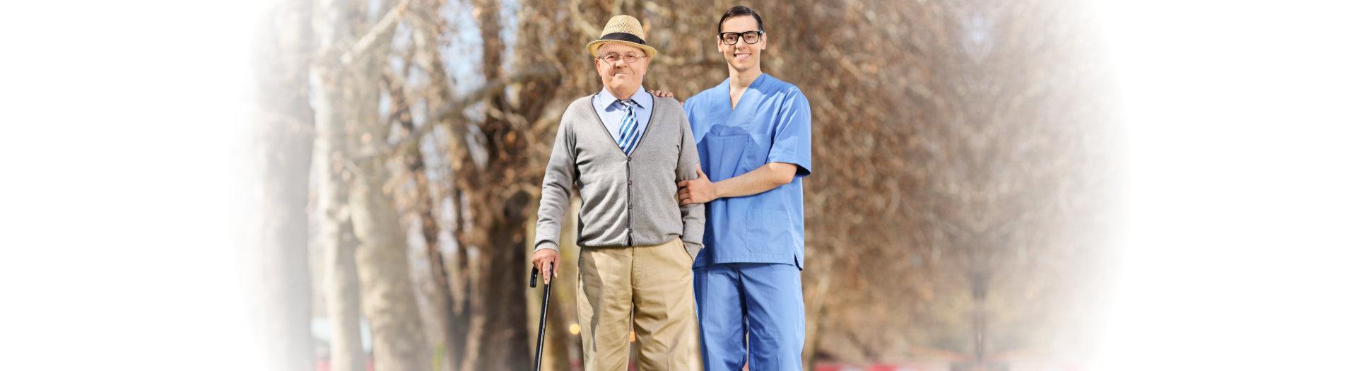 caregiver with senior man smiling