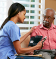 caregiver monitoring her patient's blood pressure