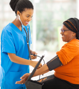 young nurse monitoring the blood pressure of her patient