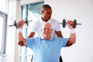 caregiver assisting his patient in doing exercise